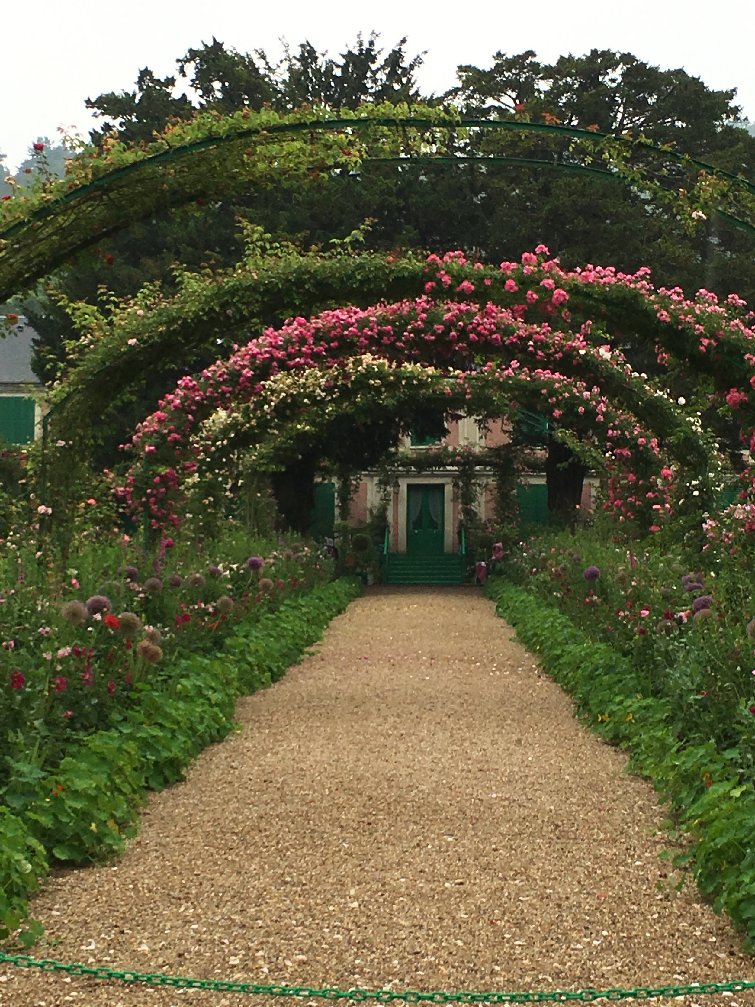 The front door to Monet's house, viewed through the rose arbors