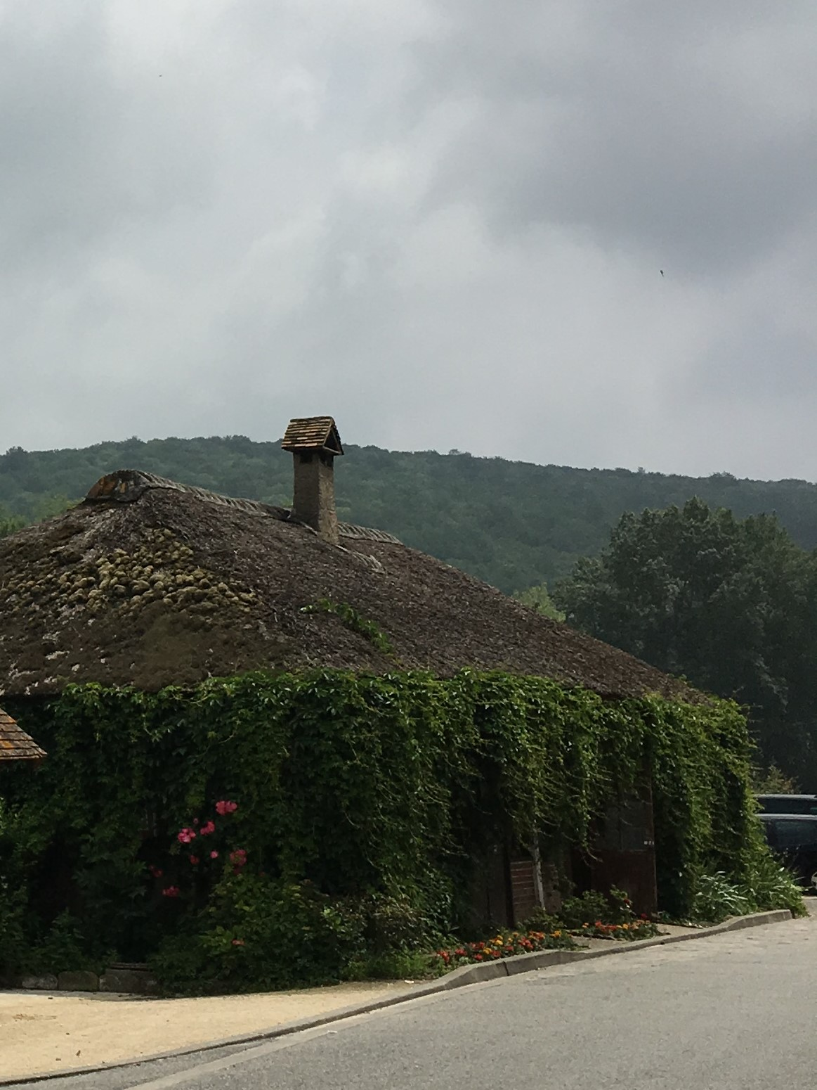 The ivy-covered walls and moss-covered thatched roof make the cafe look as though it grew out of the riverbank
