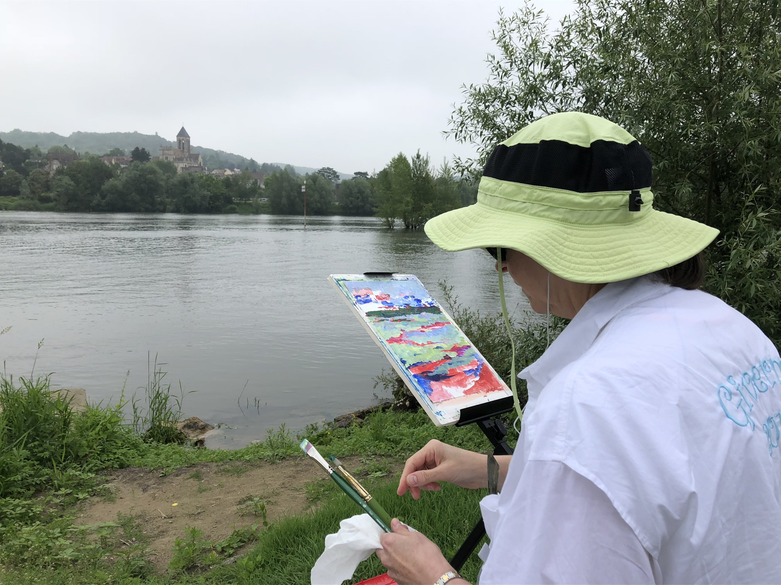 No shade in Lavacourt, looking across the Seine to Vethueil--the hat was vital! Note how I am nonchalantly sticking palette knives in shirt pockets in order to have them handy.