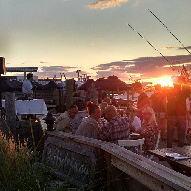 The Hideaway - Come dine in casual comfort and experience Fire Island's finest cuisine, while enjoying the fresh bay breezes and incredible sunset views.