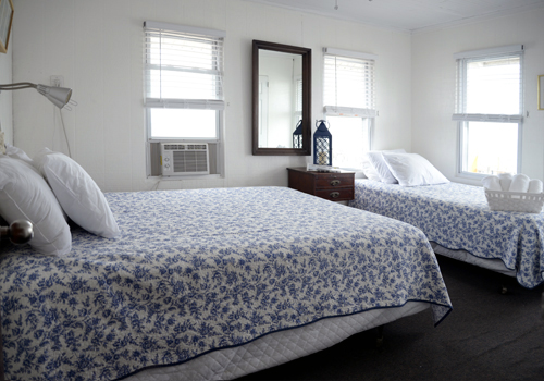 Room 4 - One queen size bed and one twin size bed, ½ bath, a/c and ceiling fan.This room is bright and comfortable and has a beautiful view over the Great South Bay. Click here to reserve.