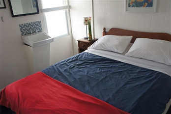 Room 5 - One queen size bed, ½ bath in the room, a/c ceiling fan.This room is bright and comfortable and has a beautiful view over the Great South Bay. Click here to reserve.