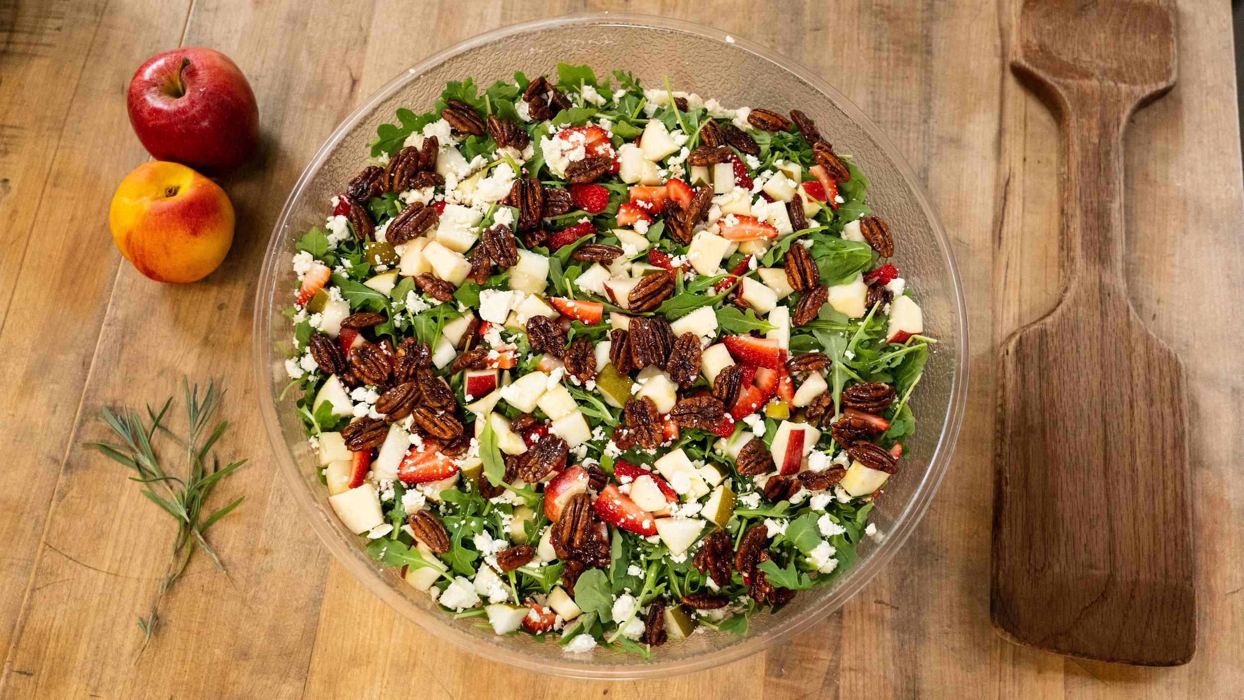 Try our Wild Arugula Salad! Ingredients: organic wild arugula, seasonal fruit, dates, feta cheese, cinammon pecans, housemade balsamic dressing