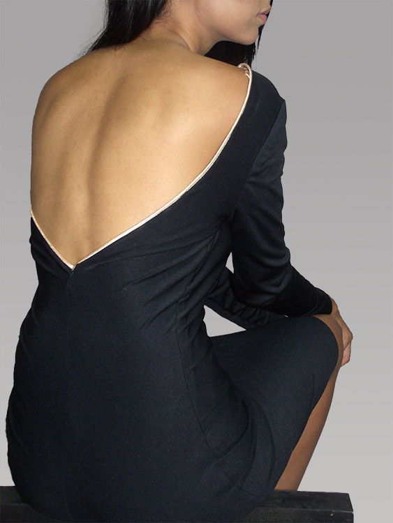 Sandeep in the backless rose gold trim petite coquette dress.