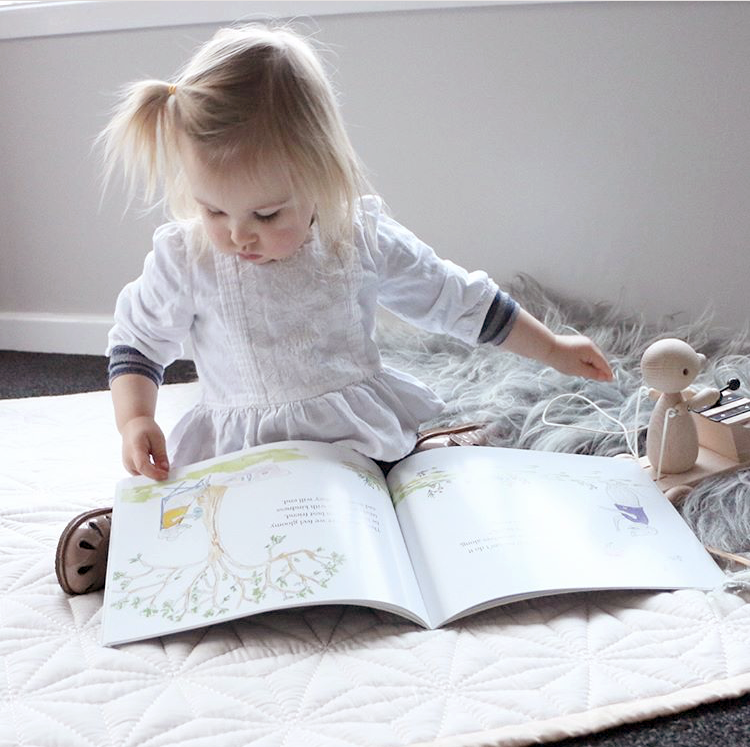 _ - @homefulloflove snapped this gorgeous picture of her little one enjoying our book 'Stand Tall Like a Mountain'. We love seeing children (and adults) enjoying special moments with our books, finding their own unique ways to be confident and stand tall from any age!