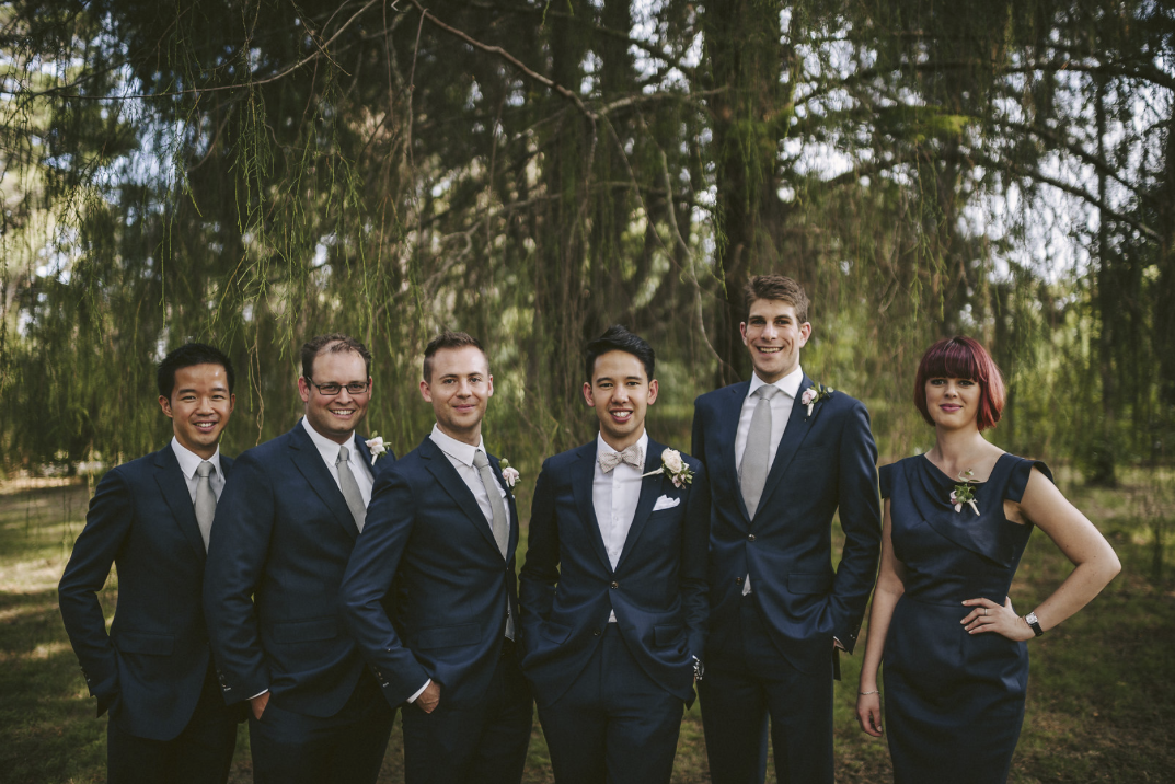 Christina's made-to-measure dress was the perfect complement to these bespoke Braddon Tailors suits. Photo by  Aparat Photography .