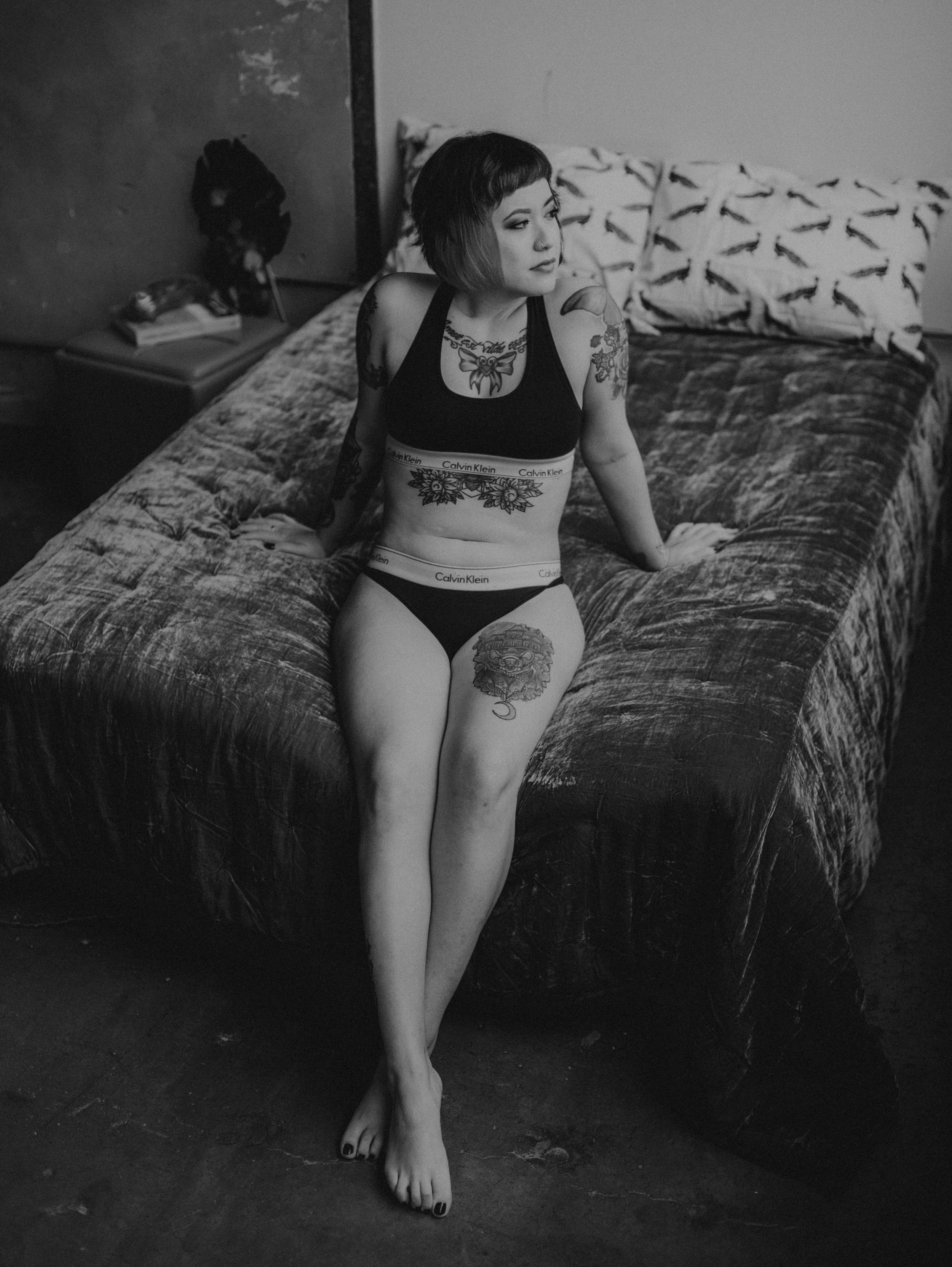 Dark beauty inspired aesthetic in soft and sensual alternative boudoir session in Dallas