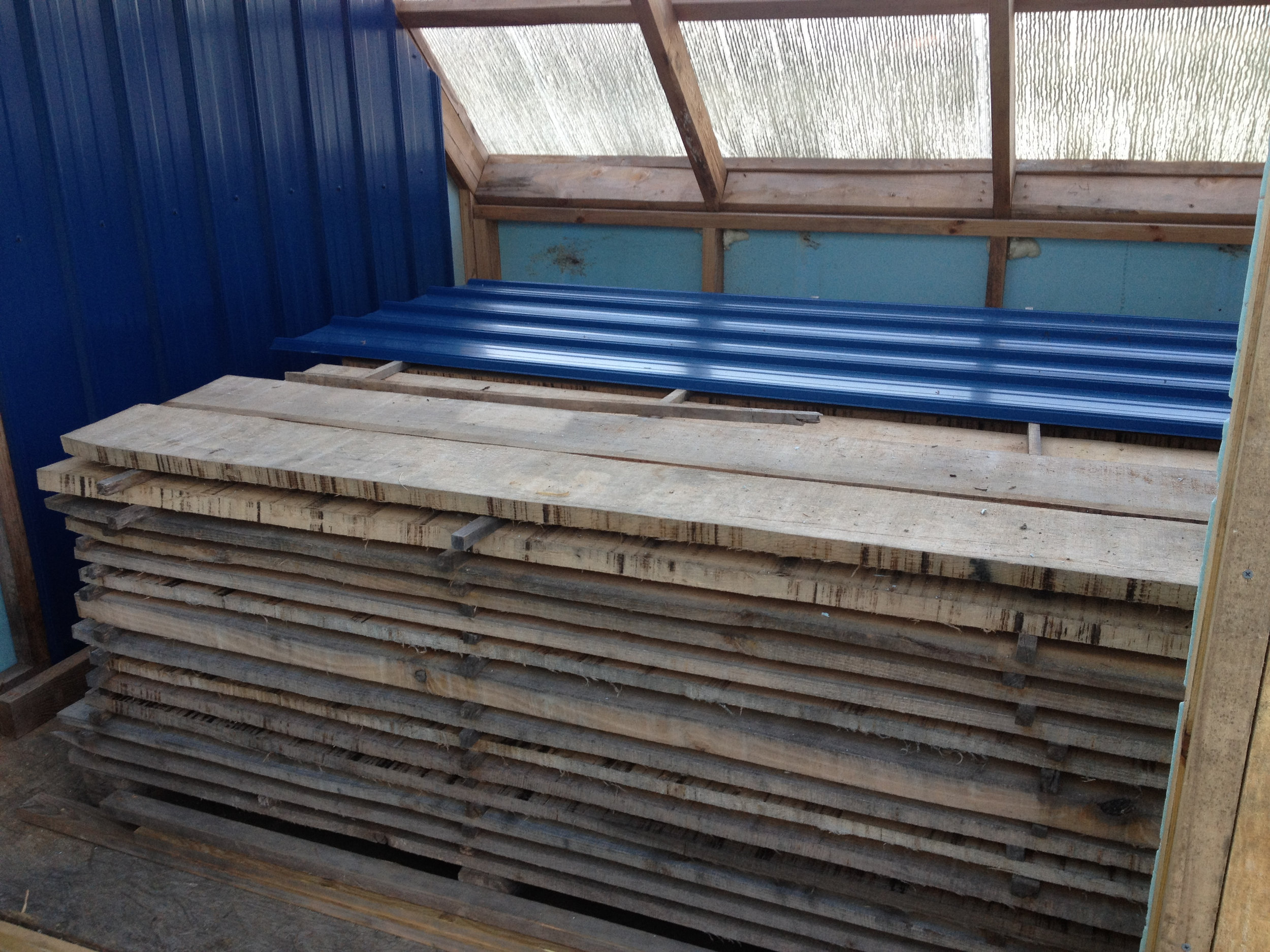 Our solar powered kiln dries lumber for cabinets and furniture!