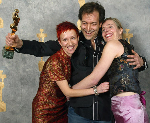 Peter Mettler with producers Ingrid Veninger and Alexandra Rockingham Gill, receiving the 2003 Genie Award for Best Documentary.
