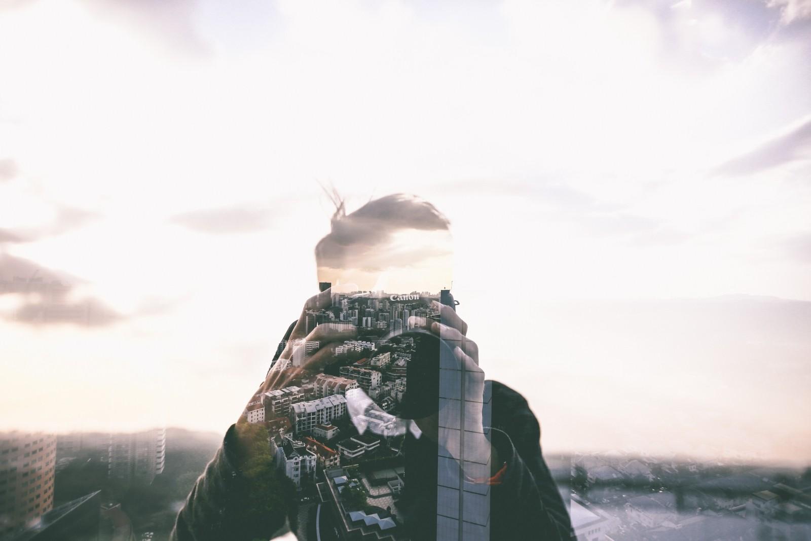 man-photographing-city-buildings.jpg