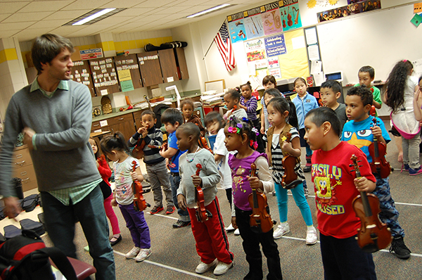 A Suzuki violin class taught by SPCM faculty in a Saint Paul school