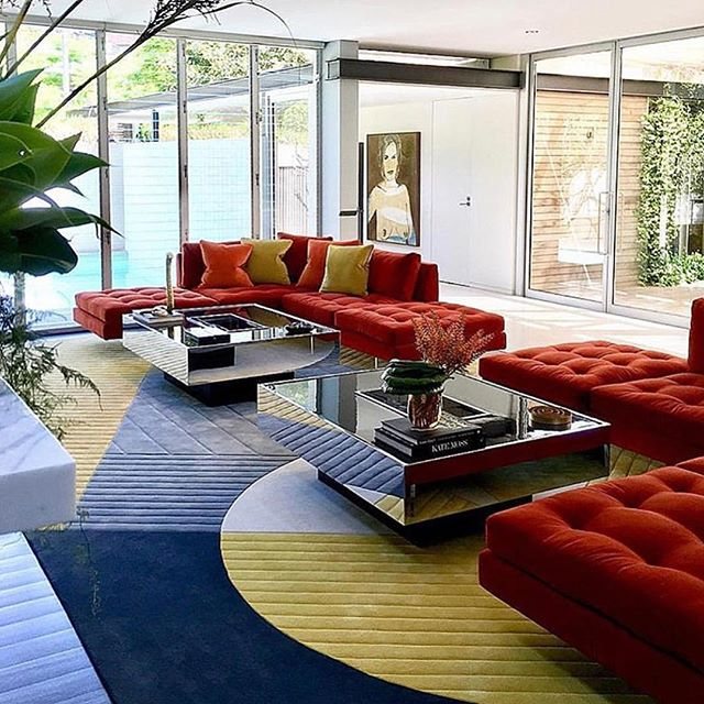 The use of colour and well curated collections come together harmoniously. . . . . . . #bonhaminterior #curated #luxe #luxury #art #colour #rugs #geometric #redlove #sofa #50s #reflect #texture