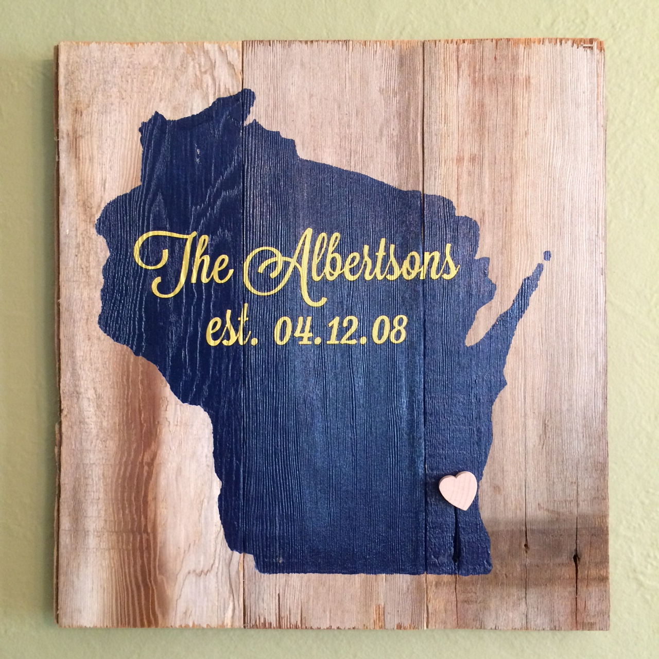 3. Love Where You Live State Sign   Home is where the heart is with these hand painted LWYL signs. Choose from a 12 or 16 inch sized reclaimed wood sign with the state and color of your choice. All states can be customized with names, dates, home coordinates, etc. and include a wooden heart tac to be pinned wherever you love.