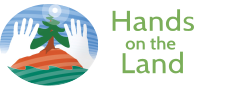 logo hands on the land.png