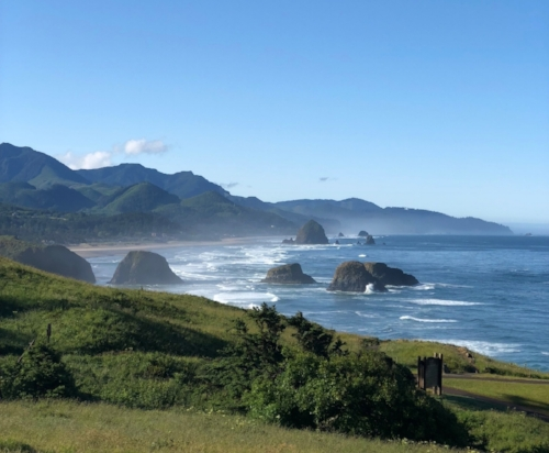 Looking south from Ecola State Park toward Cannon Beach at Bird Rocks (foreground) with Haystack Rock looming in the background.