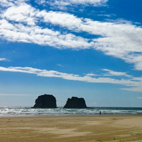 The stunning Twin Rocks are at the south end of Rockaway Beach, a 30-minute drive south from Arch Cape/Cannon Beach on Highway 101.