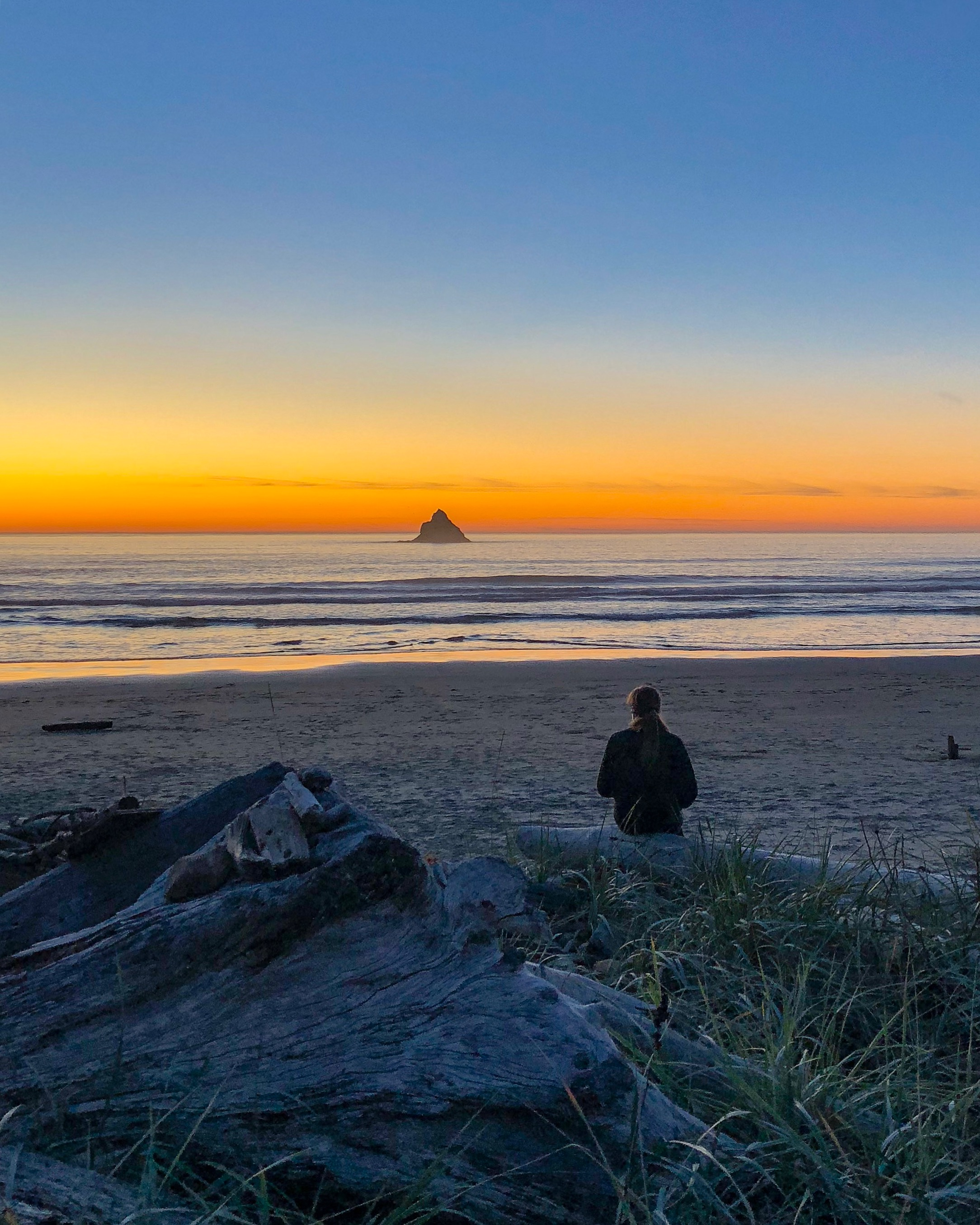 Watching the sunset in Arch Cape, Oregon