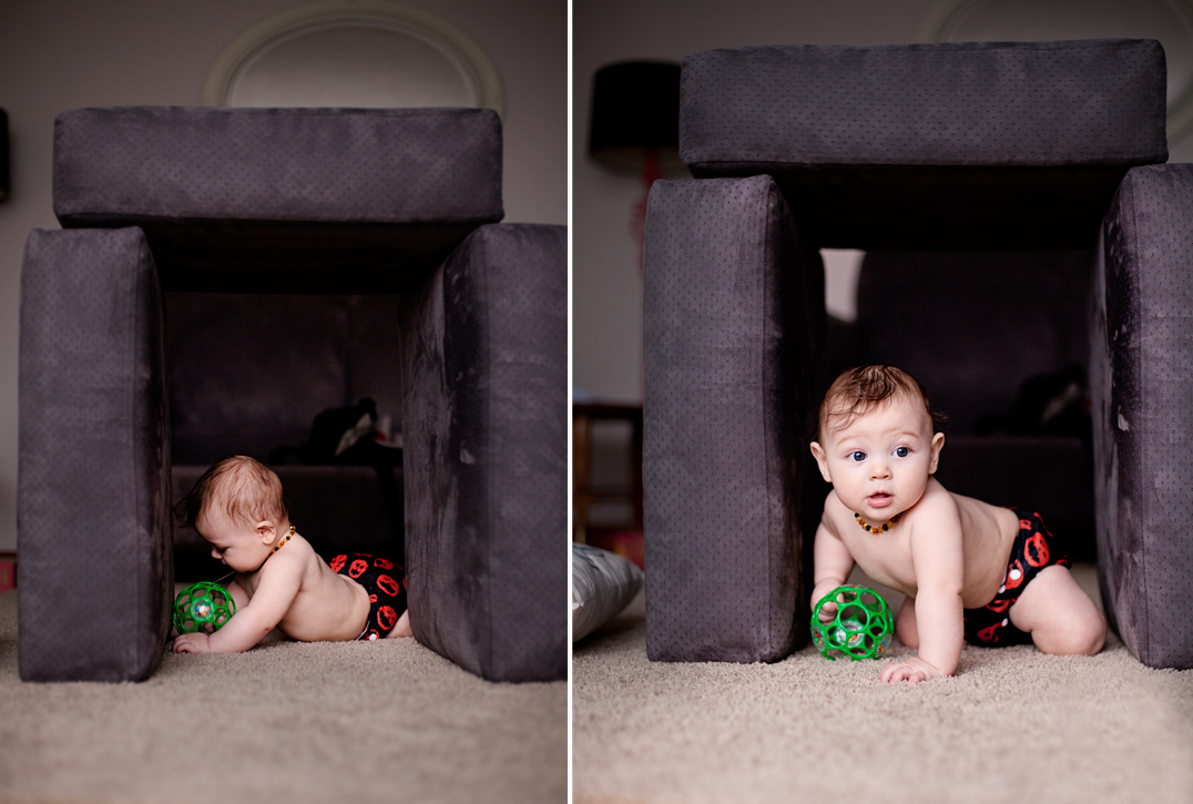 baby playing in his fort