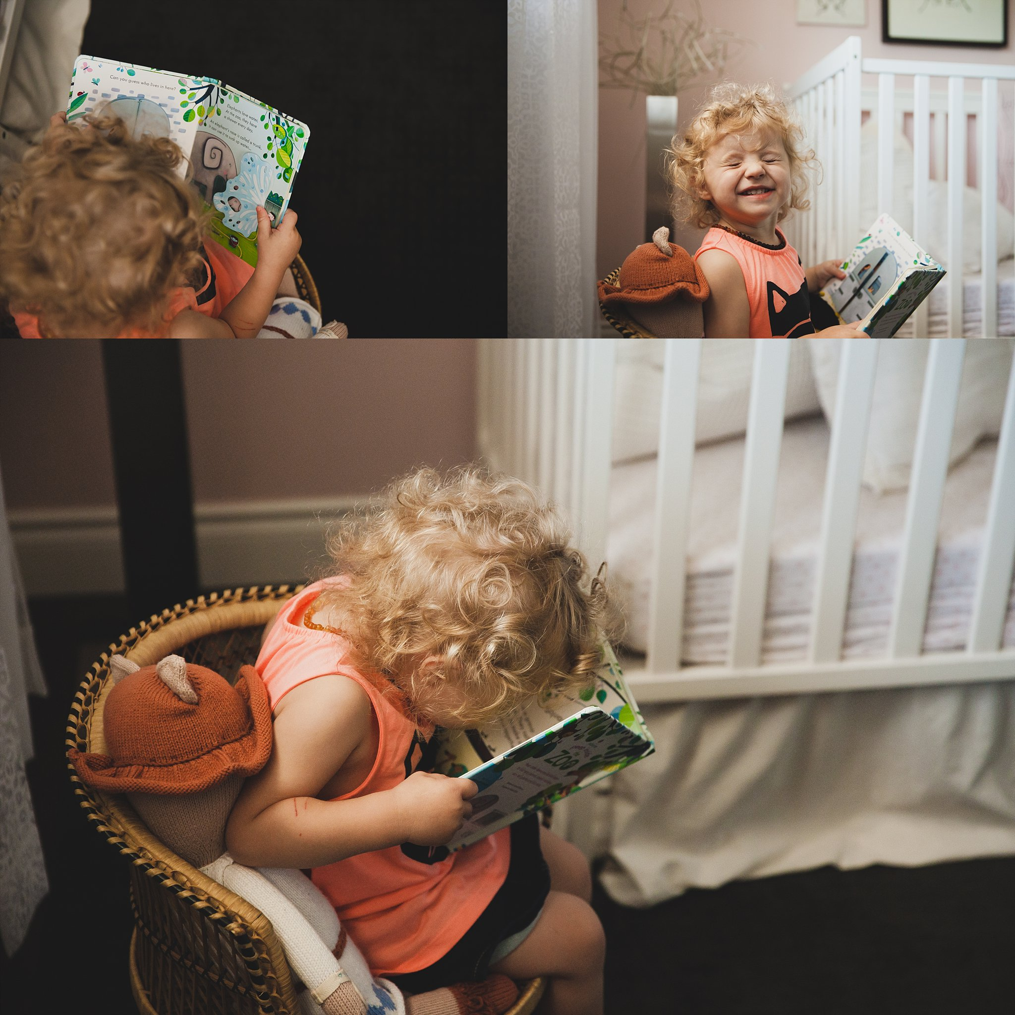 Adorable baby girl reading a book in her room.