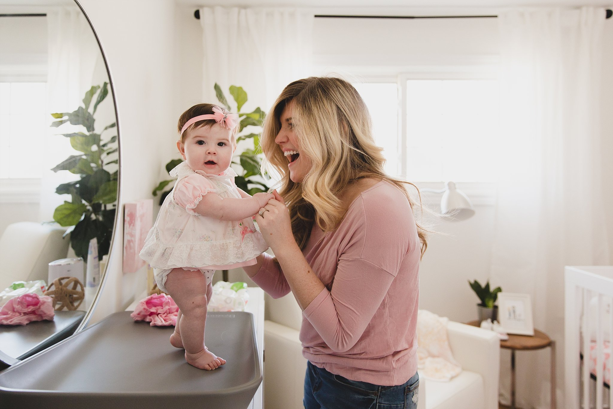 Happy Mama, Jaclyn Harper Colville in her well designed girls baby nursery in Burlington ON. Photographed by Rachael Little Photography, Woodstock ON.