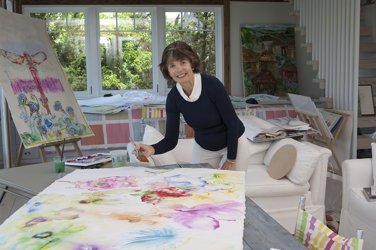 Lucy painting in her Amagansett studio. Photo by Gary Mamay.