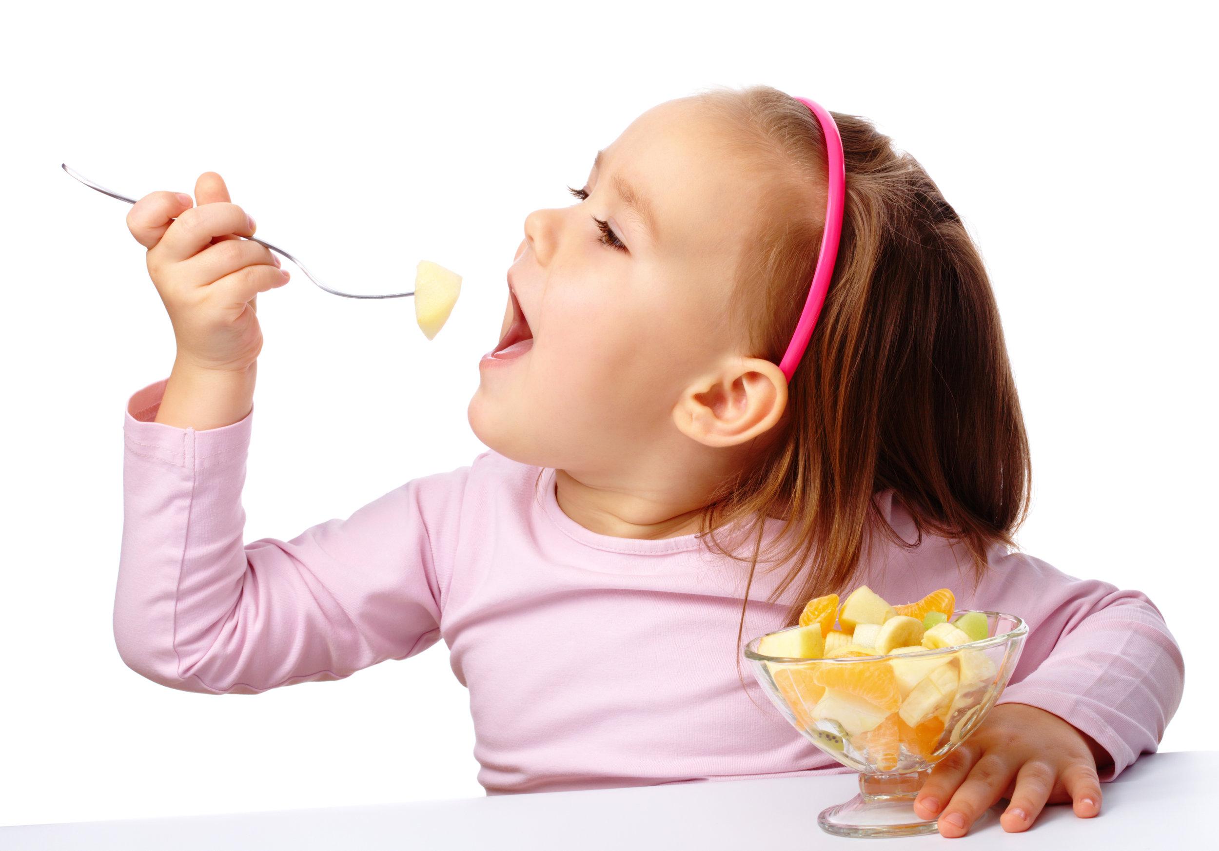 young girl eating fruit.jpg