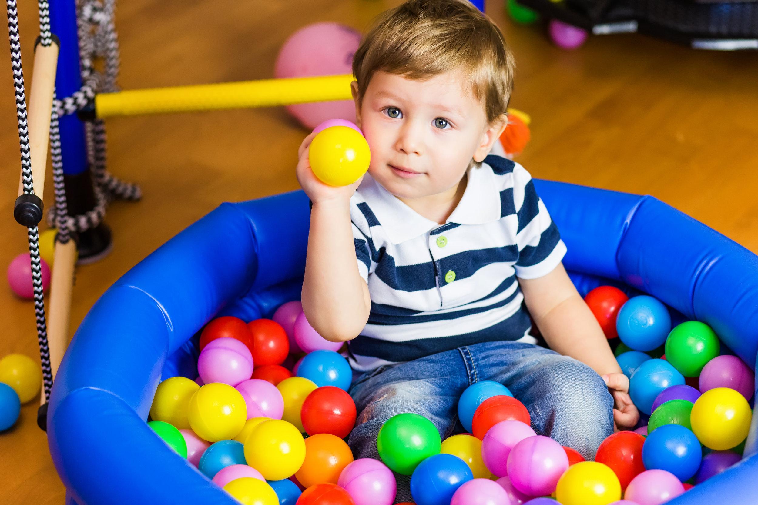 boy in ball pit.jpg