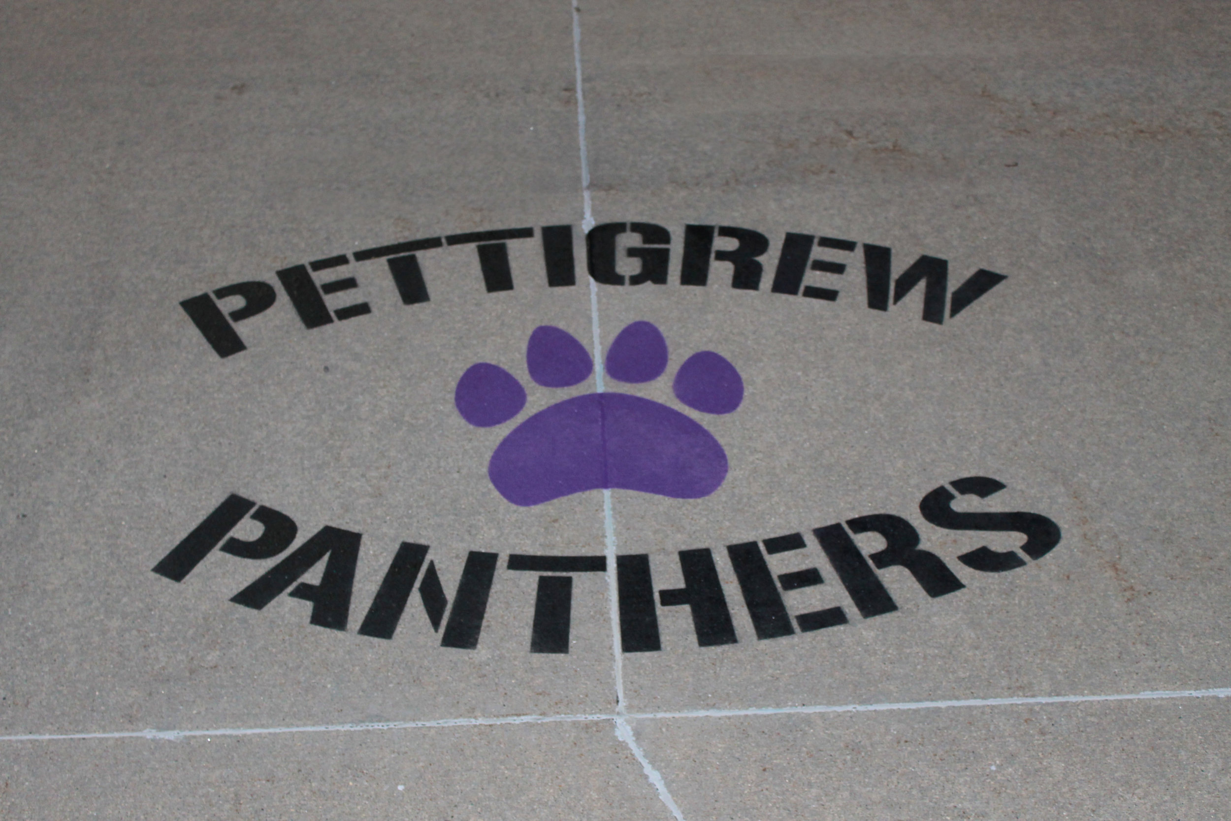 Image of Pettigrew Panthers stencil painted in front of the school.