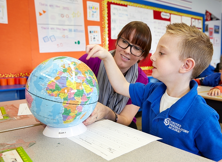 SPI-Photo-003_Student and teacher with a globe_2014_lr.jpg