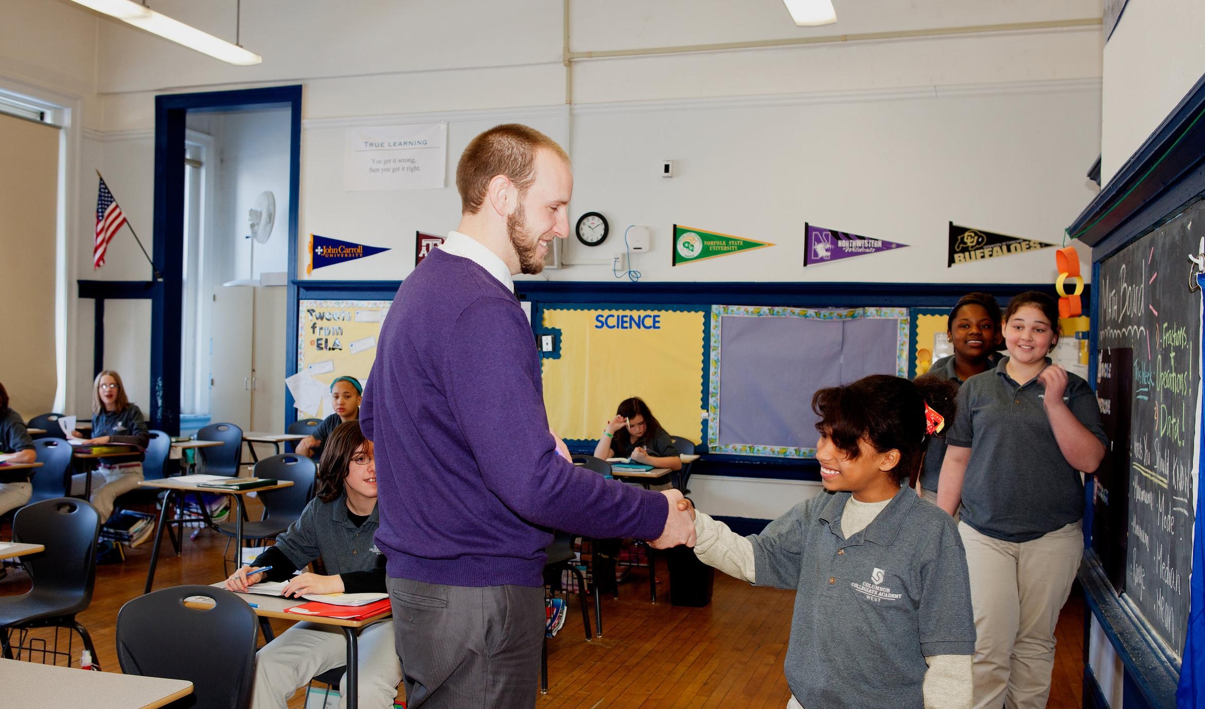 SPI-Photo-027_Teacher shaking hands_2017.jpg