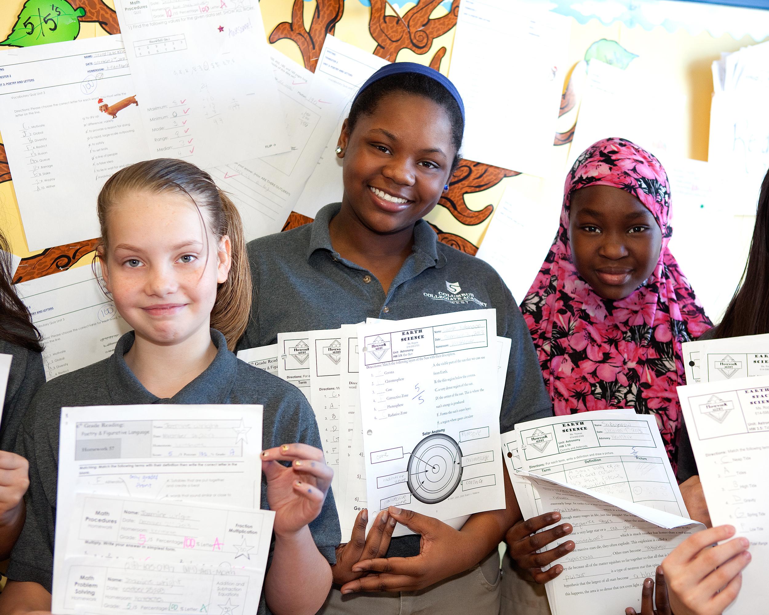 SPI-Photo-018_Three Students with grades_2014.jpg