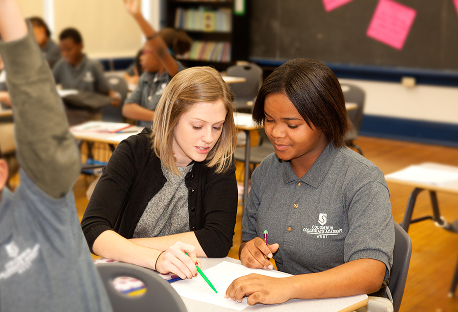 Best practices - teacher helping student with work