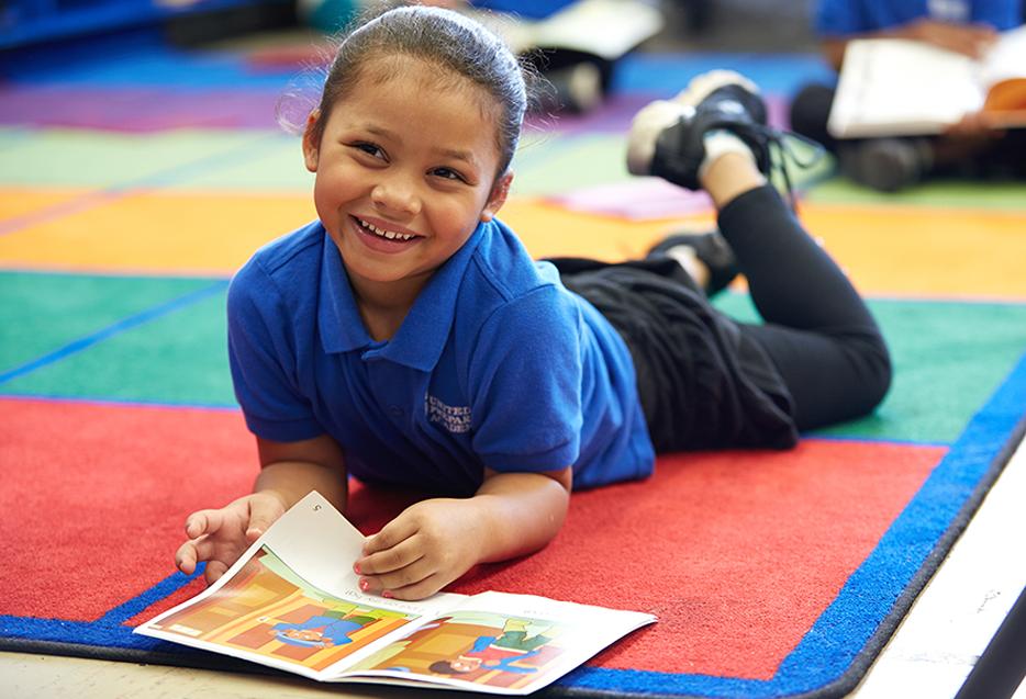 Best practices - student enjoying reading work