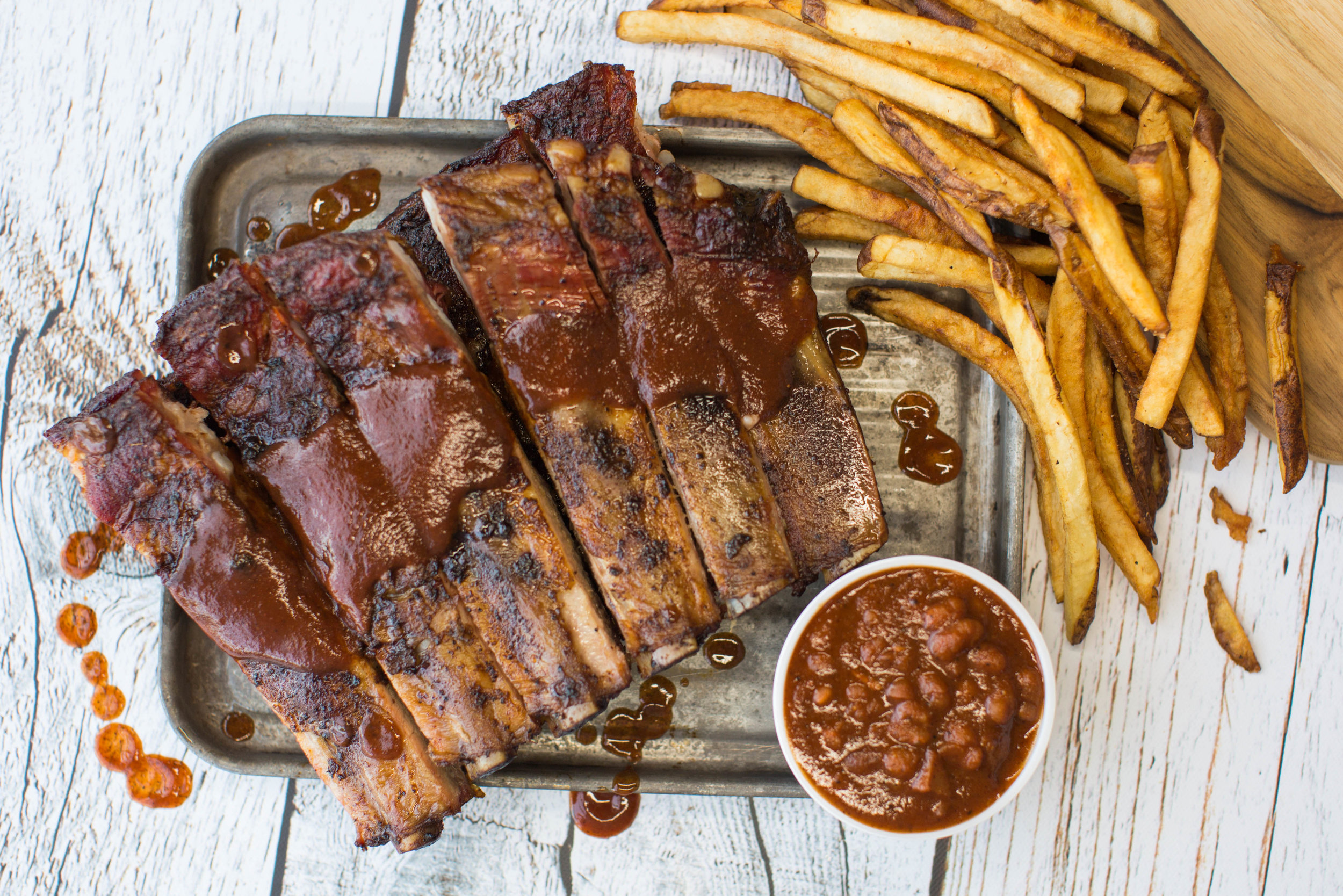 Saturday Special  Full Slab of Ribs + 2 Sides  $24.90