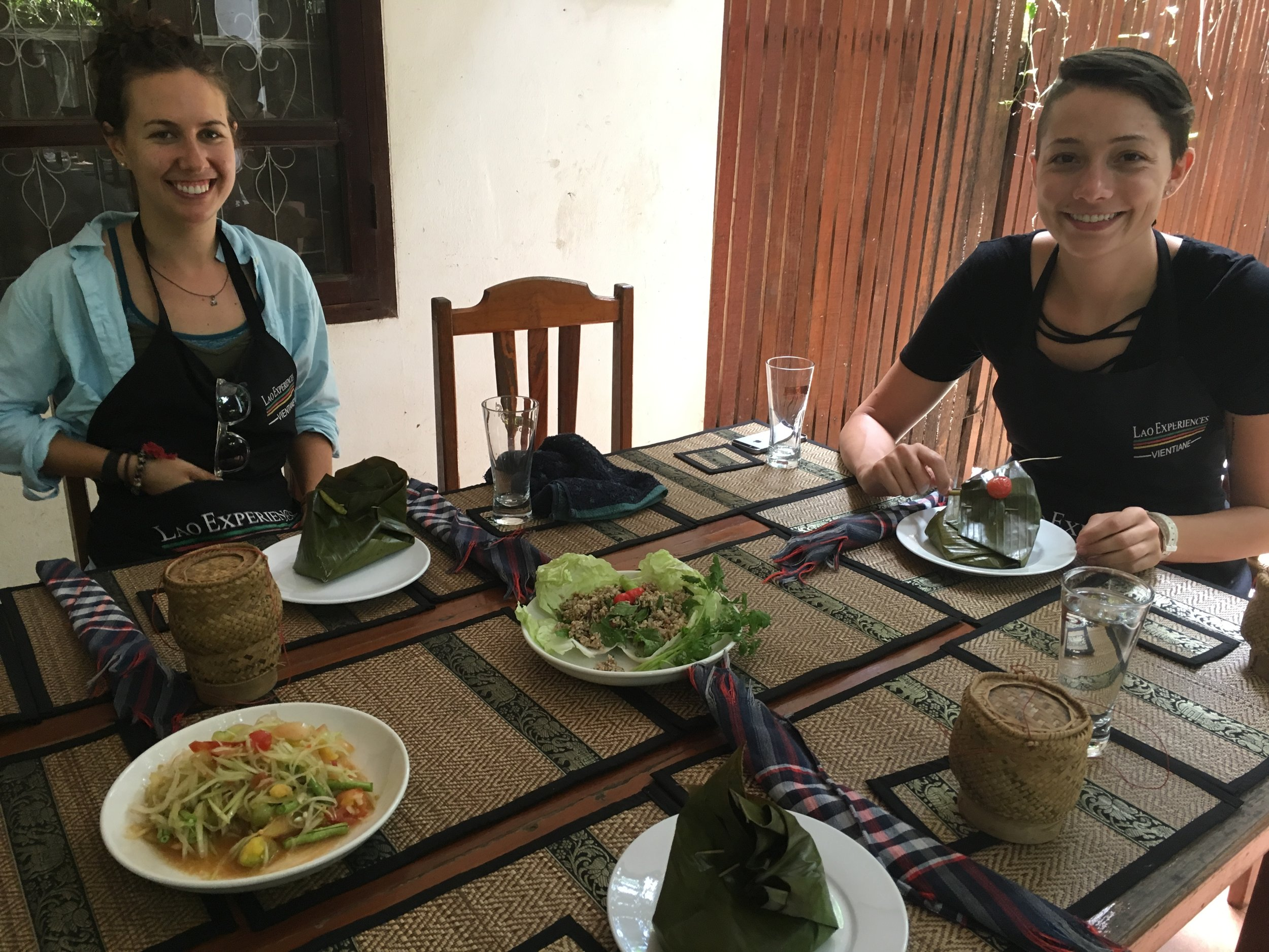Amy and Corey and our papaya salad, laap, and banana leaf-wrapped fish.