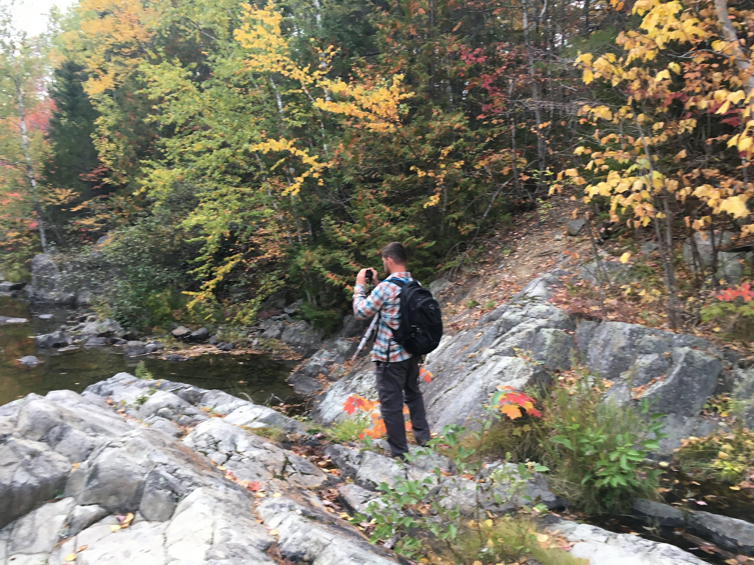 TJ takes photos in Baxter State Park in Maine.