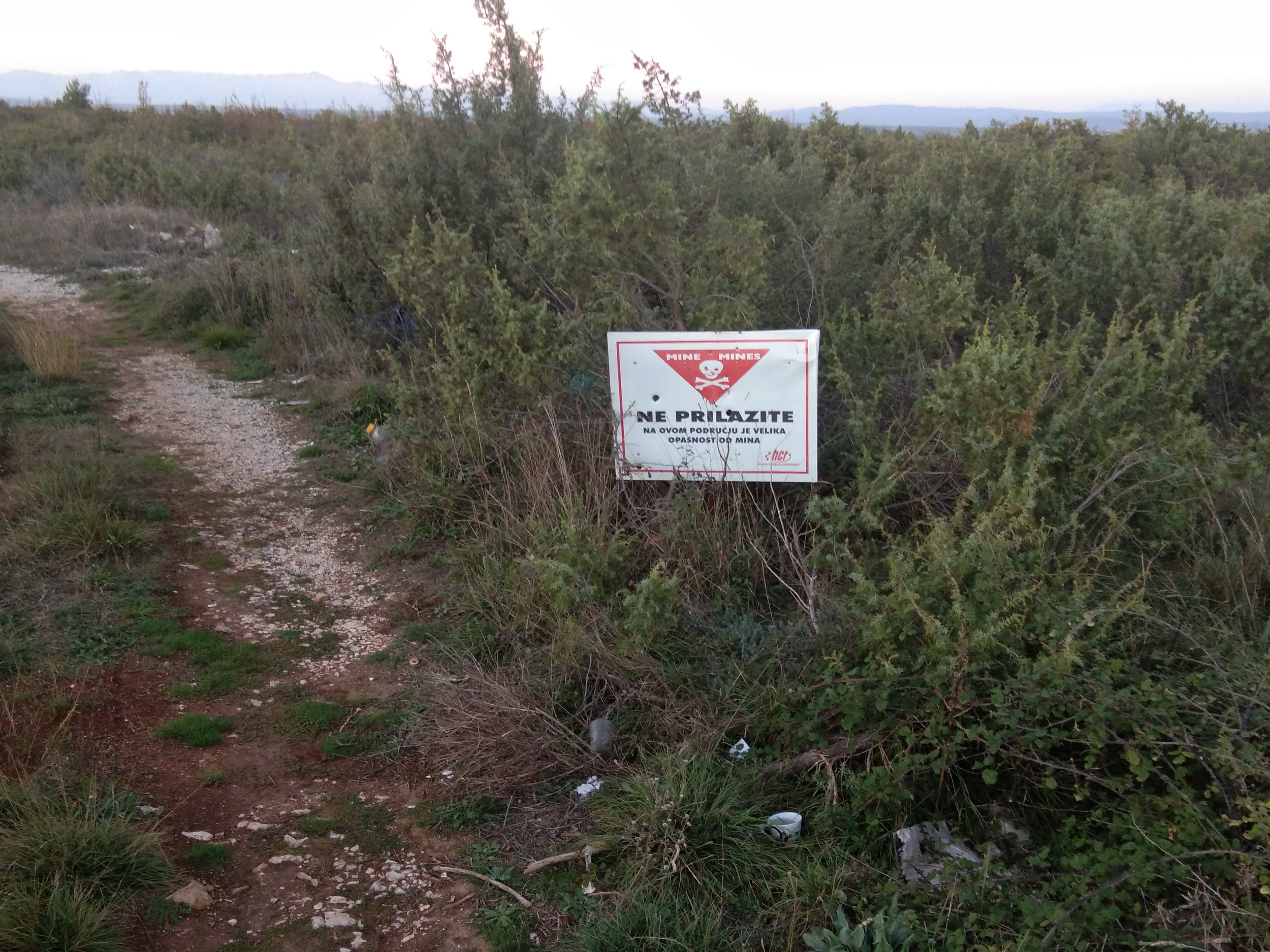 This warning sign states that the area hasn't been cleared and may contain land mines left over from the Croatian War of Independence.