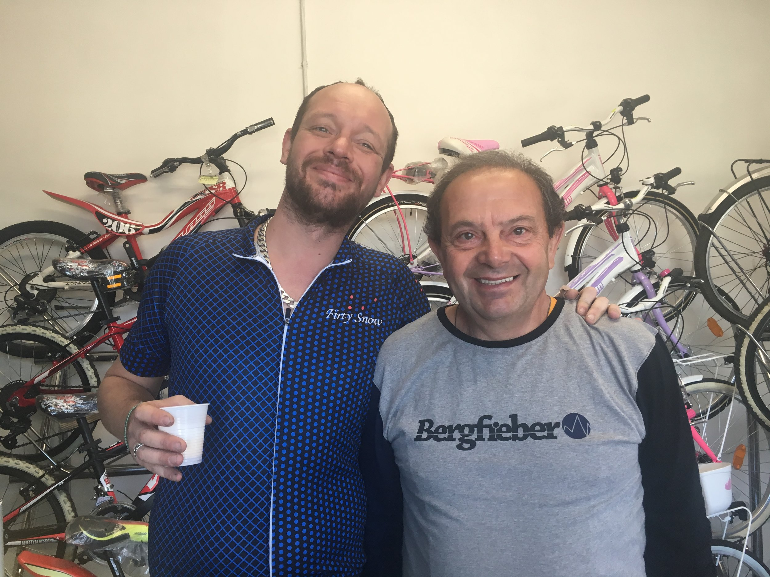 Craig and Francesco enjoy tiny cups of coffee at a bike shop outside of Isseo.