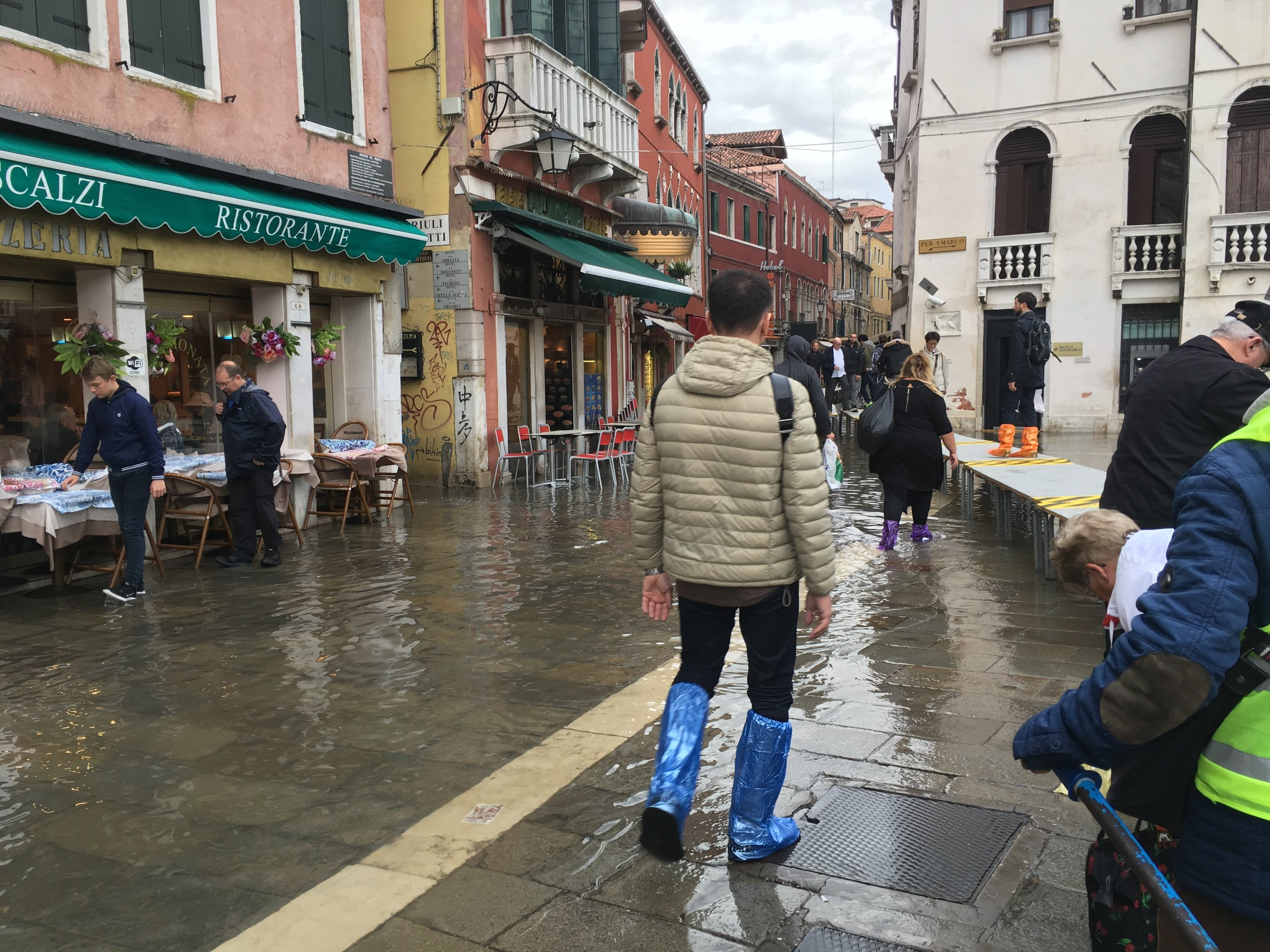 Visitors bought plastic boot covers to walk through the flooded streets of Venice.