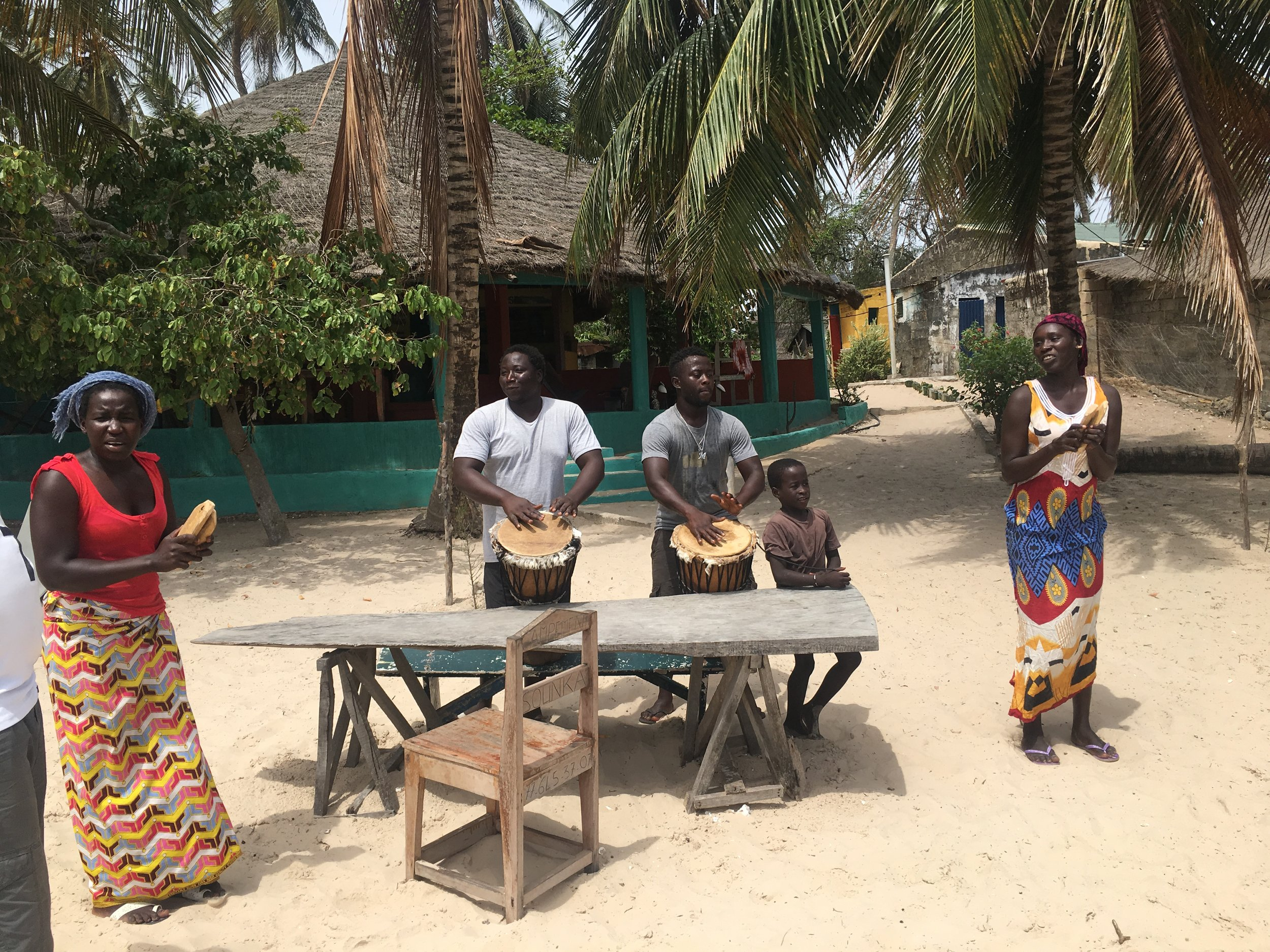 Awa, Youssou, Modou and Titina welcomed us with drumming and dancing on the beach.