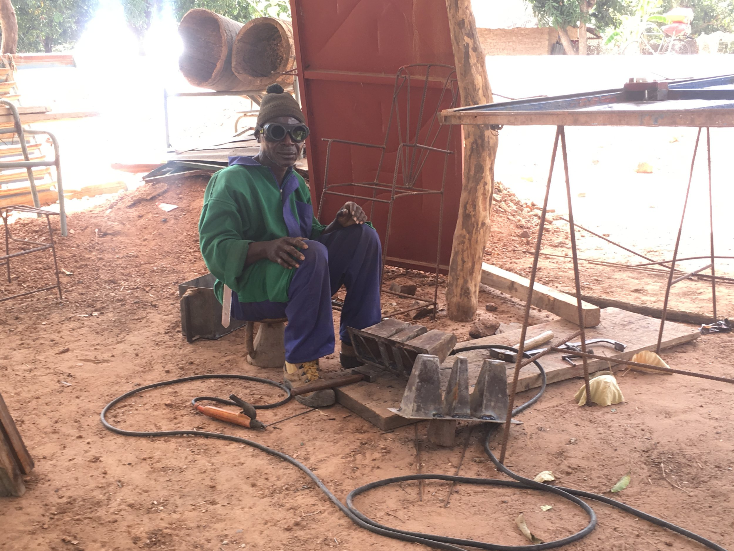 This man is soldering a mold to make cinderblocks, the building material of choice for many Senegalese buildings.