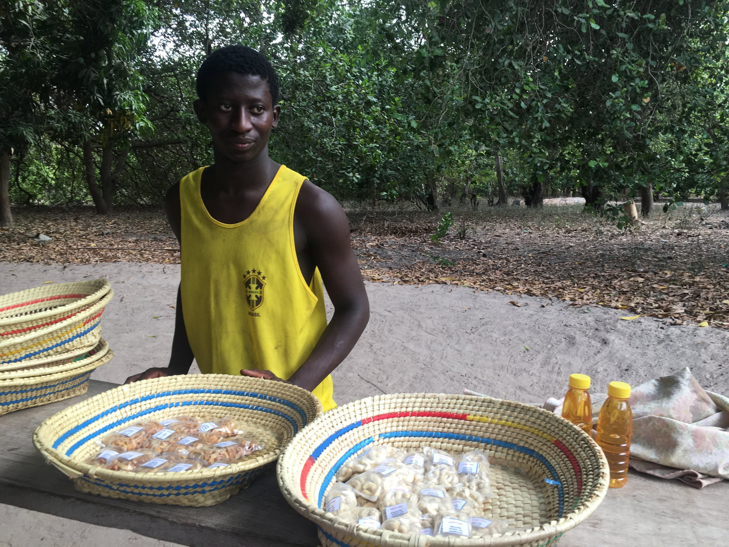Jean Sebastian sells cashew juice and several flavors of roast nuts such as honey, pepper, lime and sugared at the stand at the factory.