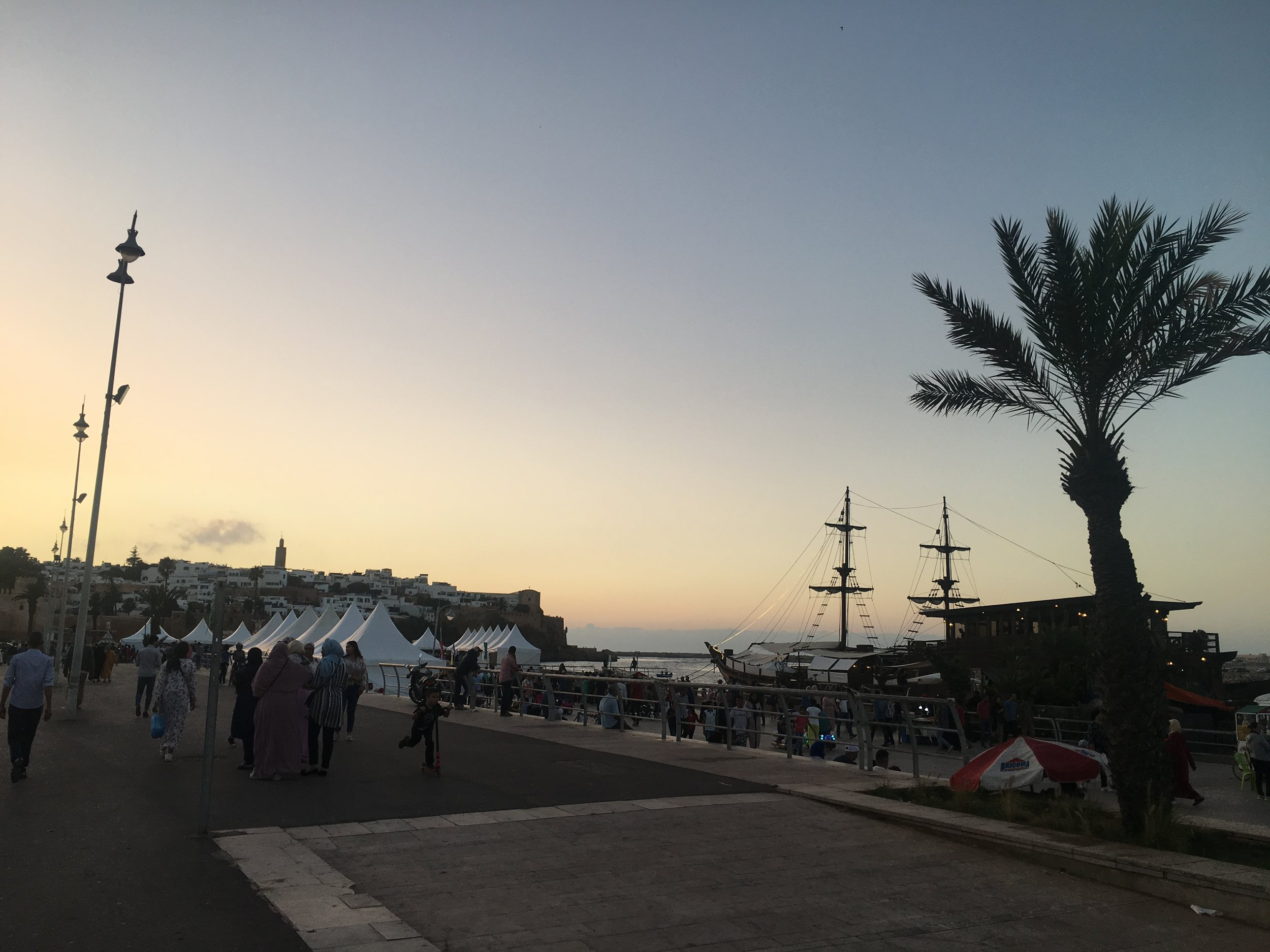 The riverfront in Rabat is a popular gathering place in the evening. Rowboat ferries bring people from Salé to join as well.