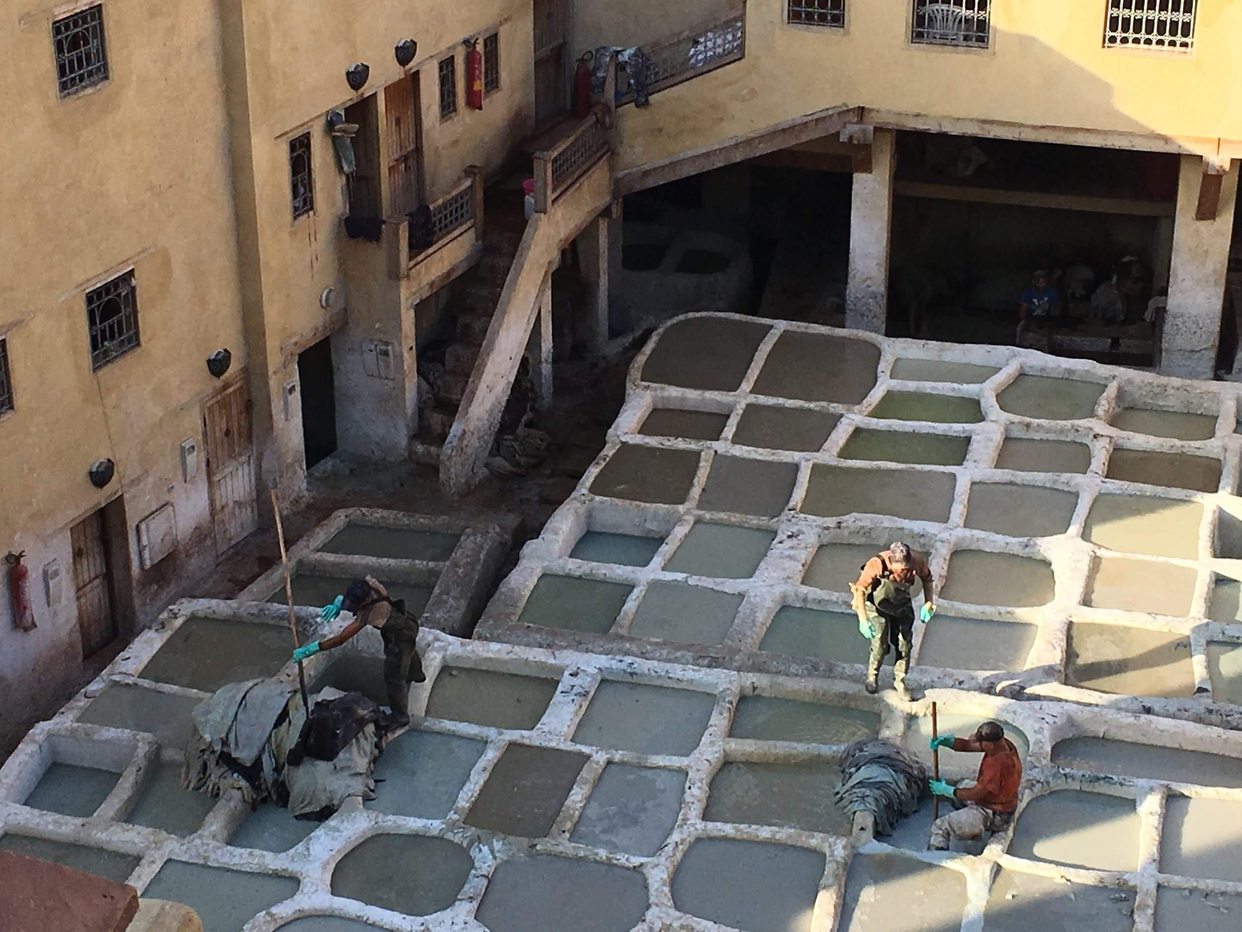 Once the hides enter the tannery, it will be soaked for a few days in white stone baths. The liquid is a mixture of water, cow urine, salt, pigeon droppings, and quicklime used to soften the hides.