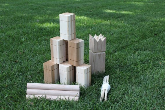 Yard Game Ideas to Keep Your Guests Smiling - Game by Handmade on Half Street- #weddinggames #yardgames #weddings