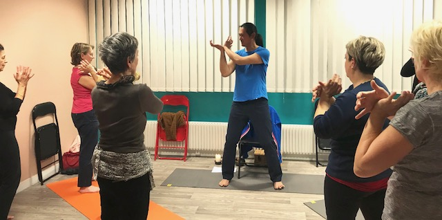 Joo teaching qigong at the wellness centre in Saint-Lô
