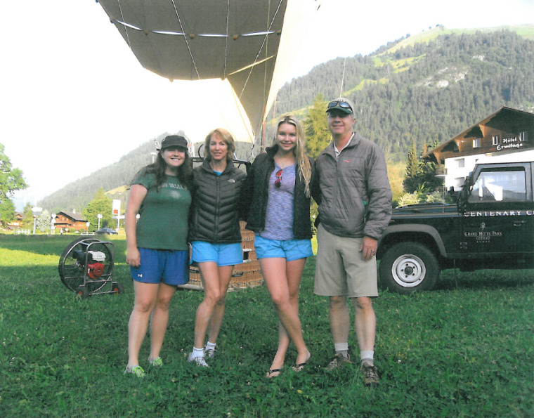 The Adamson family is pictured here before a hot air balloon trip in Switzerland last August. Grant Adamson was killed when the balloon hit power lines and fell 165 feet, while each of his family members suffered serious injuries.  From left: Lauren, Terry, Megan and Grant Adamson