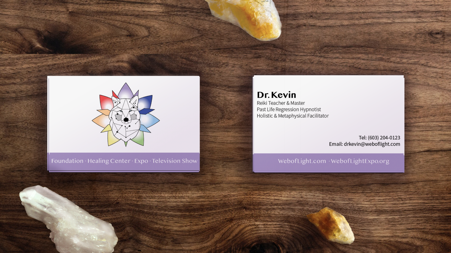 Modest business cards designed for cofounders of the foundation highlighting individual expertise & directing recipient to the WOLF website.
