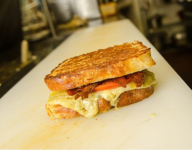 Have you tried our Grilled Cheese? It is ooey, gooey, and oh so good with melted shredded cheddar, gruyere, Maytag bleu, heirloom tomato, and crispy prosciutto on our white bread. Special thanks to Bryan with BSCENE for the awesome picture!