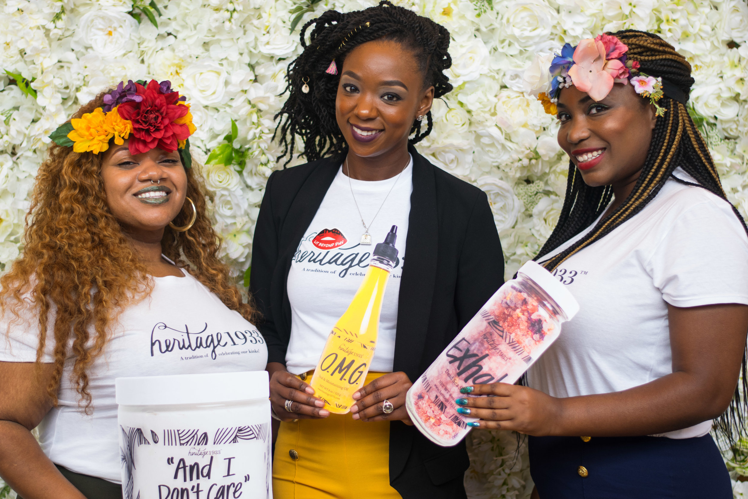 Latoya Thompson, middle, takes a photo with her company team at The Naturalista Hair Show on Saturday, Sept. 16, 2017. Based out of St. Louis, Missouri, Heritage1933 is a beauty and hair care company with a social purpose. For every product sold, Heritage1933 will donate a hair product to a shelter in need.